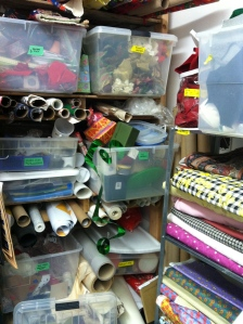 Boxes of trims and bolts of fabric.