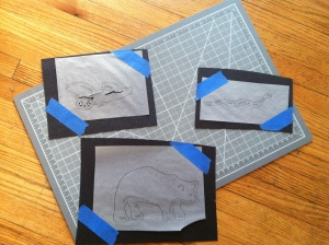 Puppets in process of being cut out. After they are cut, we add velcro, sometimes to both sides so we can flip them.