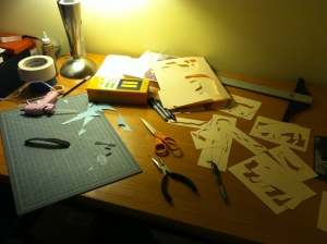 Between the puppets and the stencils for the workshop, the living room table got rather messy.