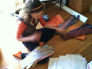 Genna sorting our many scraps of handmade paper.