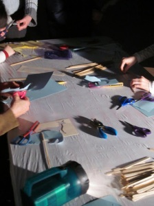 Lots of busy hands cutting out shadow puppets.