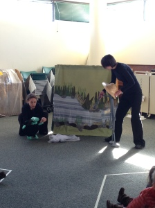 Anansi (performed by Cecilia Cackley) tries to trick Turtle into catching fish for him.