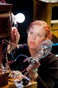Puppeteer Amie Root, in CABINETS OF KISMET with Lightbulb Head. Photo by C. Stanley Photography.