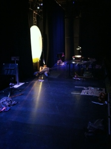 The view backstage, with the shadow screen, puppet tables and masking.