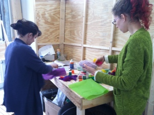 Amy and Genna at the worktable.