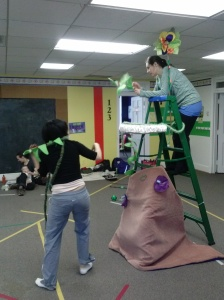 Cast members Nora Achrati and Betsy Rosen work with the objects and puppets to bring the rainforest to life.