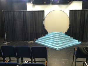View of the pyramid and screen from the audience.