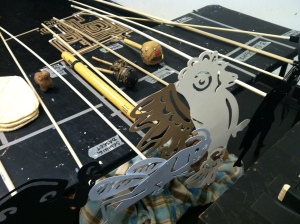 Puppets and instruments on tables backstage.