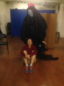 Carol reacts to a rehearsal puppet.