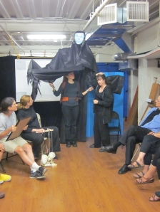 Carol and Amy demonstrating with the Black Annis rehearsal puppet. Photo by Patricia Germann.