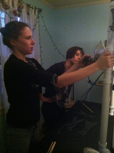 Genna and Emily work on placing a clip light.