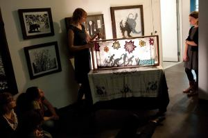Katherine performing one of her crankies at the opening of her paper cut and shadow puppet exhibit at The Creative Alliance in Baltimore, with Anna Roberts Gevalt and Elizabeth Laprelle.