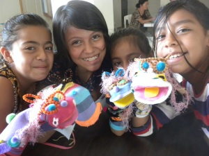 Students in El Salvador show off their sock puppets.